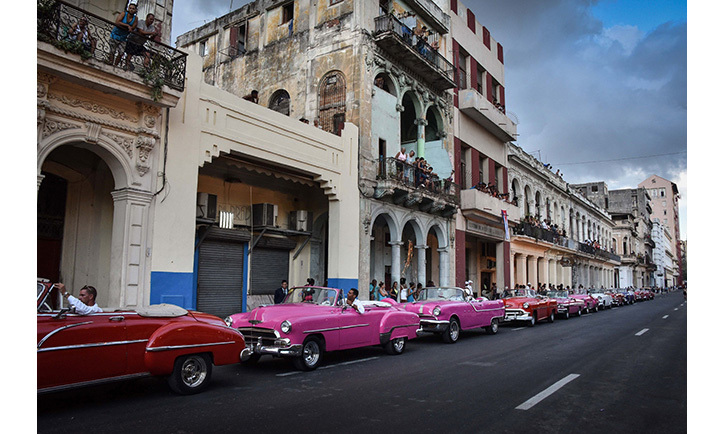 Vibrant-coloured cars lined the streets of Havana.