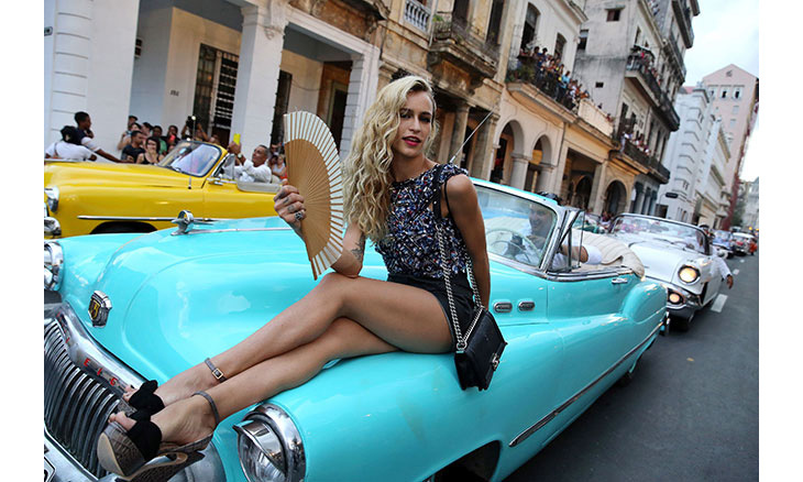 Alice Dellal kicked back on a car and looked amazing as she fanned herself.