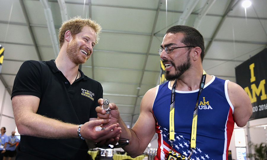 Before competition officially started on May 8, the nonpartisan prince made sure to visit with members from every team. Here, he has a laugh with an athlete from Team USA. 