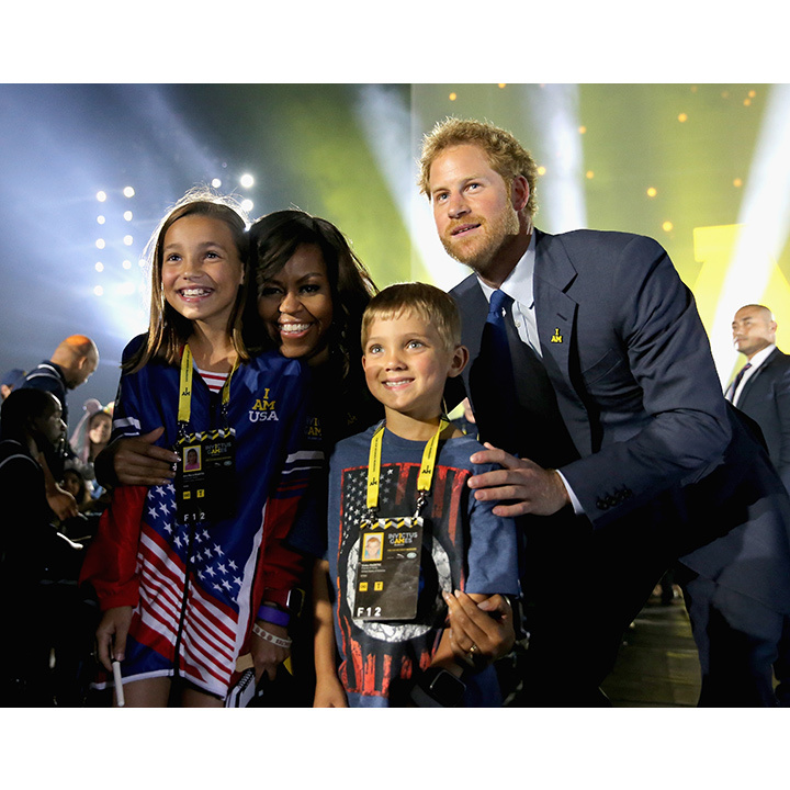 "Michelle Obama called Harry ""prince charming"" during the Invictus Games kick off party. 