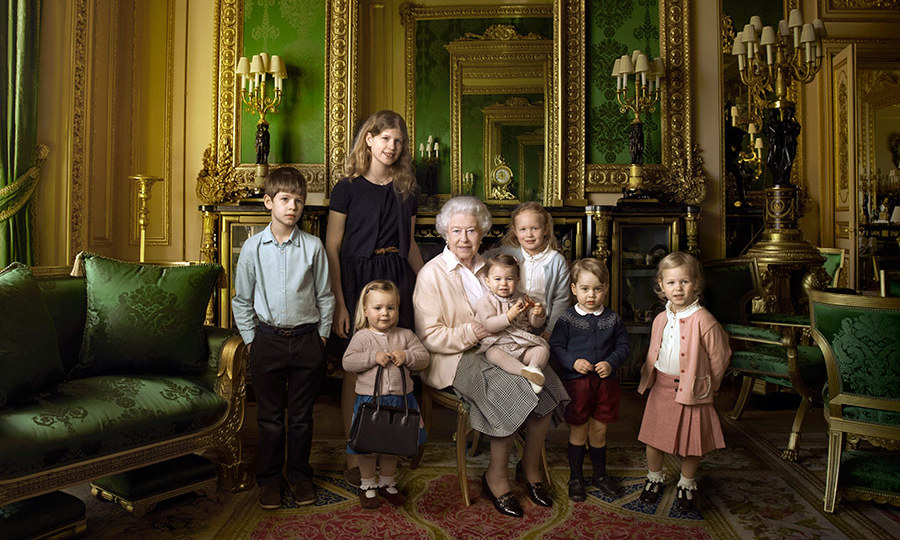 Her Majesty posing with her two youngest grandchildren Louise and James, and her five great-grandchildren.