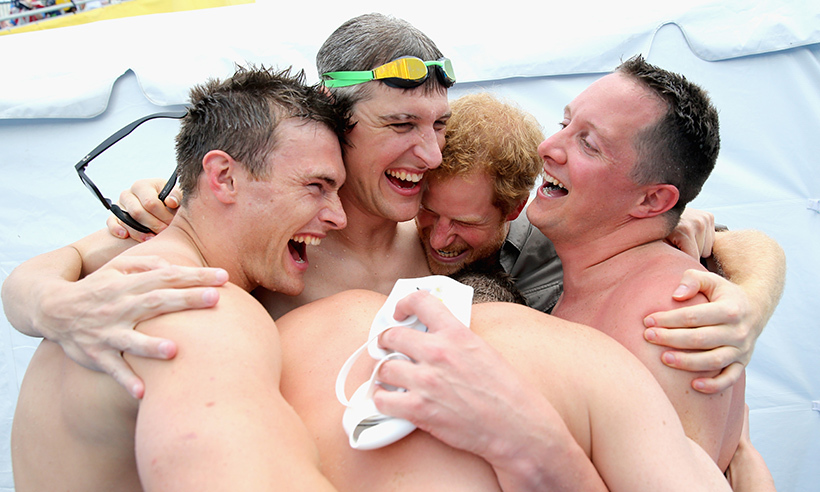 Group hug! Prince Harry celebrates with the UK's Relay team following their gold medal-winning performance. 
