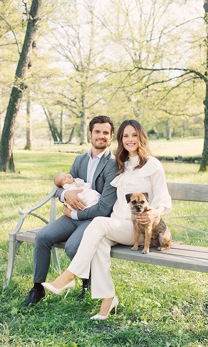 The family posed in the grounds of their home with their adorable pet dog.
