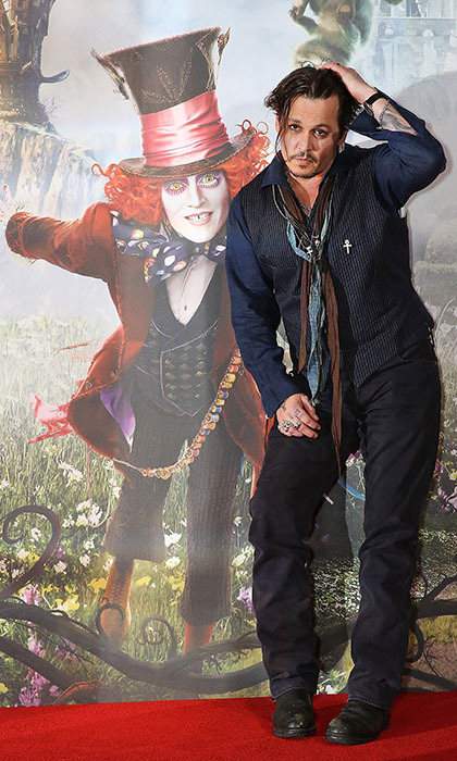 Johnny Depp posed with his alter-ego Mad Hatter at the London photocall for <i>Alice Through the Looking Glass</i>. 