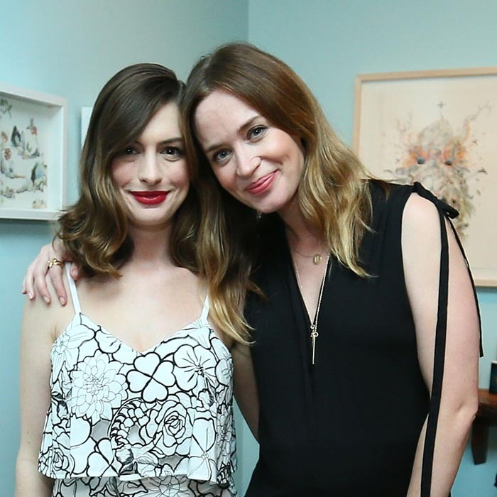 <i>The Devil Wears Prada</i> alum Anne Hathaway and Emily Blunt reunited at an <i>Alice in Wonderland</i>-inspired fashion event in Los Angeles. 