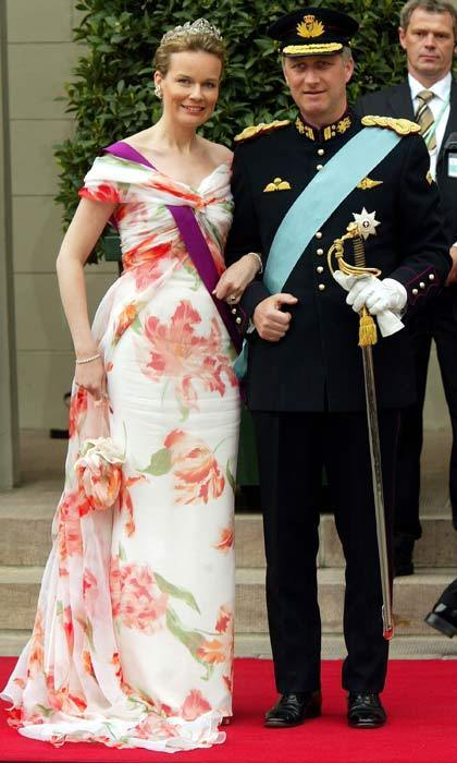 Then Princess Mathilde of Belgium opted for a white floral-print dress. The royal's light summery gown brightened up the dark skies that were clouding over Copenhagen.