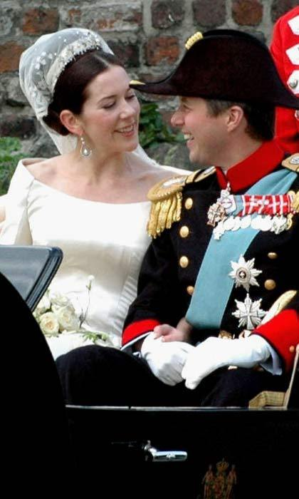 The look of love. The newlyweds could hardly take their eyes off each other as they were taken in an open carriage, accompanied by outriders and an escort of the Royal Danish Guard Hussar Regiment, to their wedding reception.
