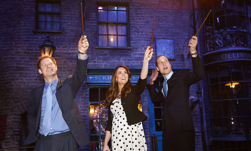 The dynamic trio tried their hands at a little wizardry while on a visit to the Harry Potter exhibit at London's Warner Bros. Studios in 2013. Kate was pregnant with Prince George at the time. 