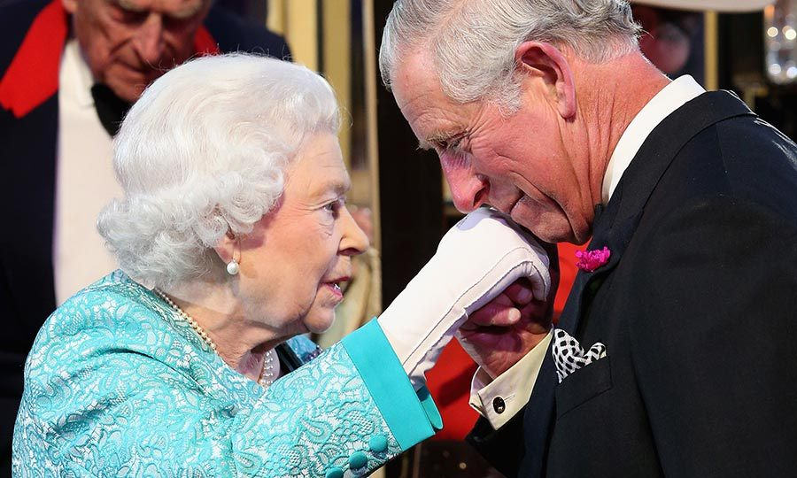 Prince Charles kissed his mother's hand when she arrived at the arena.