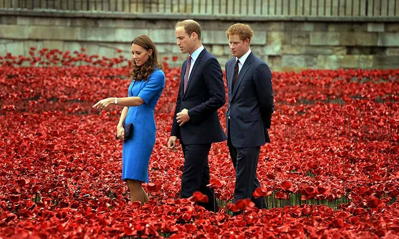 The trio pay their respects to the fallen while touring the Tower of London's 'Blood Swept Lands and Seas of Red' poppy installation commemorating the 100th anniversary of the First World War. 