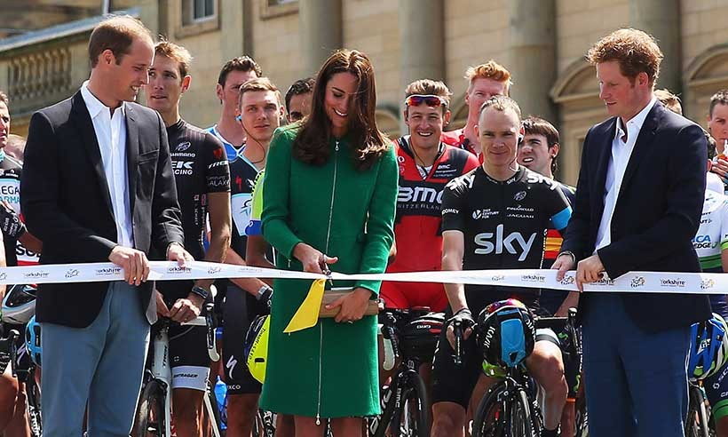 Cutting the ribbon to signal the start the first stage of the 2014 Tour de France. 