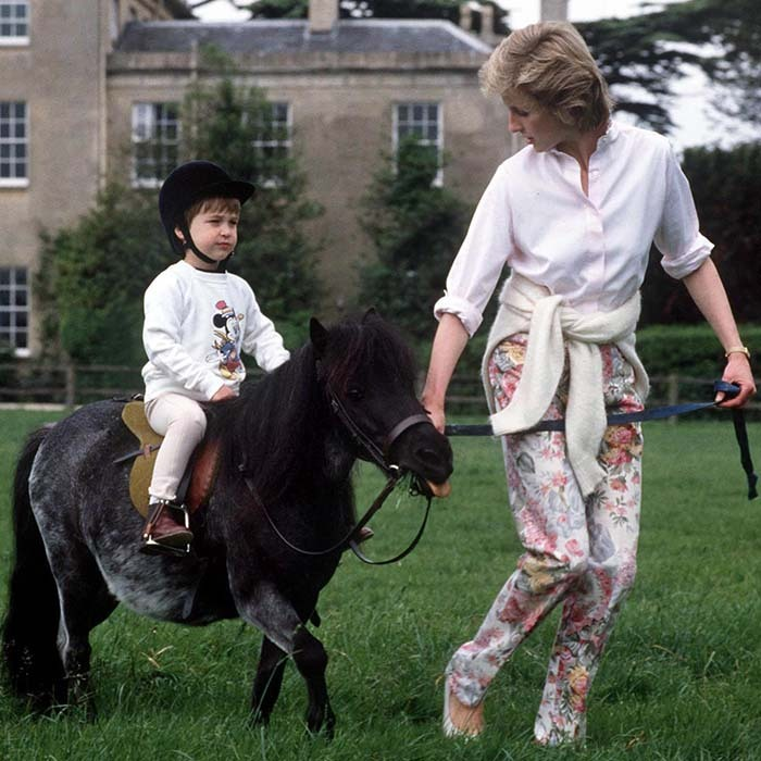 Prince William proved to be a natural in the saddle at a very early age. Here he is aged four being led around Highgrove gardens by his mother, Princess Diana. 