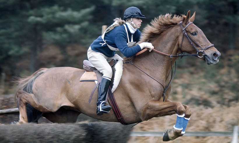Princess Anne's life has always revolved around riding horses, therefore it's no surprise that her daughter Zara went on to make a career out of it. Here, the Princess Royal competes at the Crookham Horse Trials in 1972. 