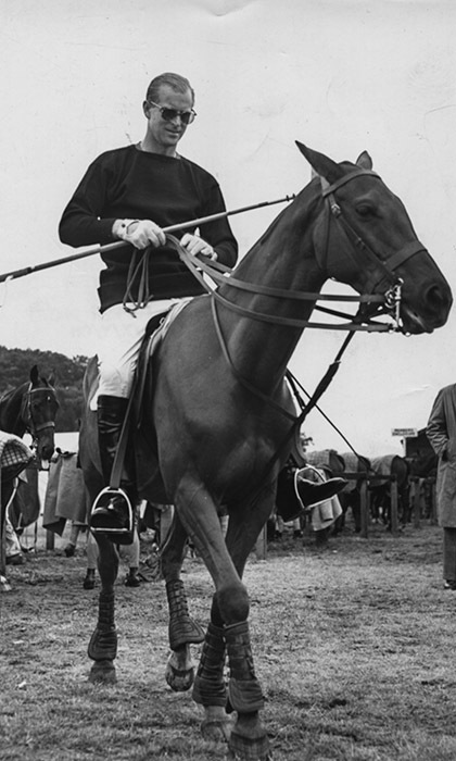 Polo-loving Prince Philip and his four-legged teammate prepare to hit the field at Windsor Great Park in 1957. 