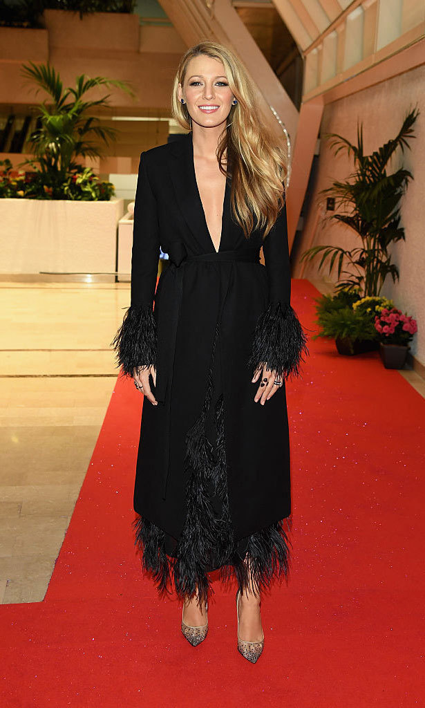 Blake changed into a plunging, feathered Salvatore Ferragamo coat dress to attend the festival's opening night gala dinner.
