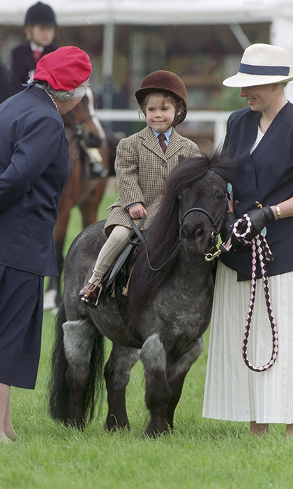 The Queen's granddaughter Princess Eugenie, 4, saddles up at the Royal Windsor Horse Show in 1994. 