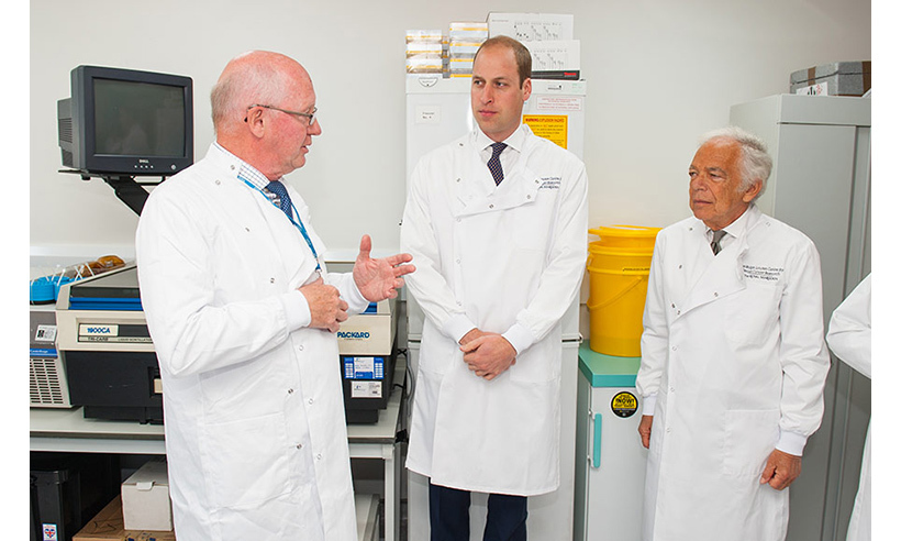 The royal toured the new breast cancer research centre with designer Ralph Lauren.