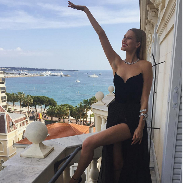 Clad in her Ulyana Sergeenko gown, model Toni Garnn (@tonigarnn) showed off some leg - and her hotel's spectacular view - before heading out to a Cannes premiere.