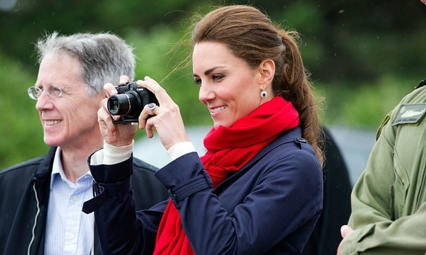 Queen Elizabeth's photographer says that Kate Middleton is a natural when it comes to taking pictures.