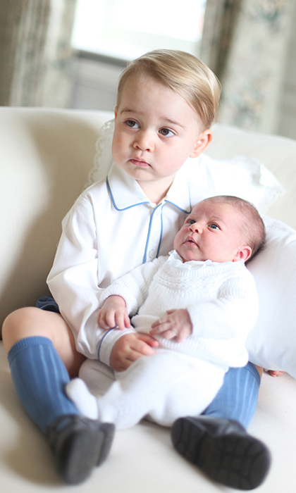 Kate snapped this picture of George and a newborn Charlotte inside of their residence.