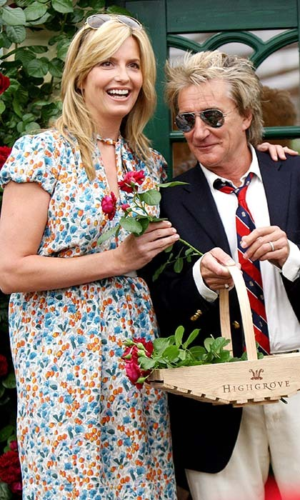 "Penny Lancaster and Rod Stewart pose for photos with a basket of fuchsia blooms in 2009. The wooden receptacle says ""Highgrove,"" the name of Prince Charles's garden.