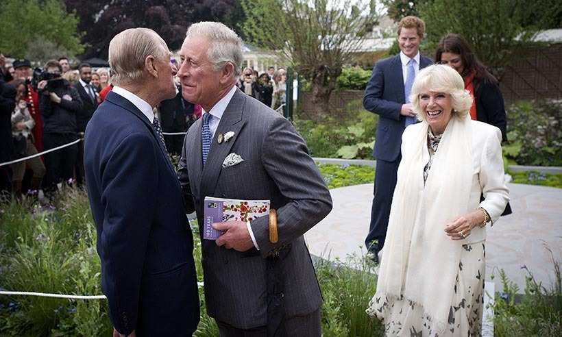 Prince Philip greets Prince Charles and Camilla as they arrive at the 2013 show en route to visit Prince Harry's Forget-me-not garden - created to benefit his charity Sentebale.