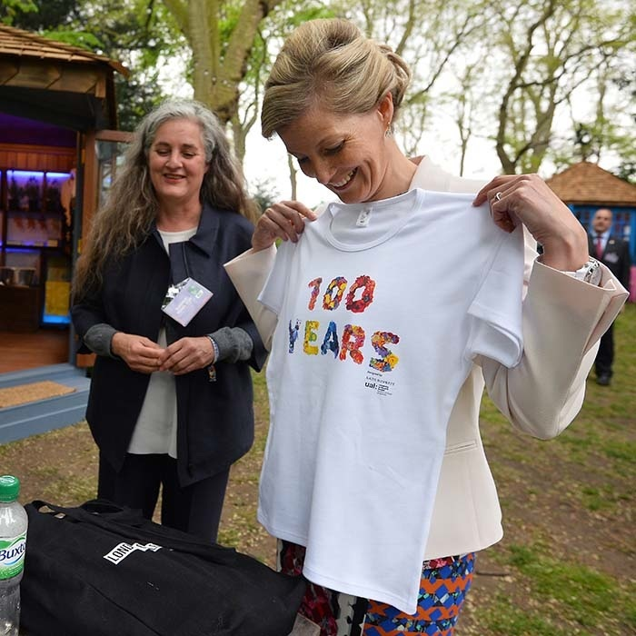 Sophie Wessex holds up a T-shirt  in 2013 marking the Royal Horticultural Society's centenary year putting on the flower show. The piece was presented by London College of Fashion course leader Susan Postlewaite and student Anya Crab in the Homebase Garden.