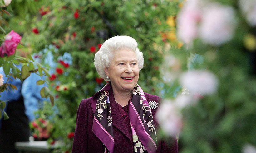Queen Elizabeth can't help but smile as she explores the spectacular floral displays in 2006.