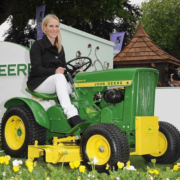 Zara Phillips trades her horse for a tractor in 2013 while at the flower show's VIP preview.  
