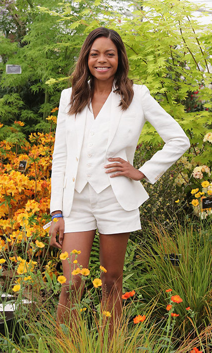 Naomie Harris posed in the gardens at the 2016 Chelsea Flower Show, where the actress wore a chic white three-piece short suit.