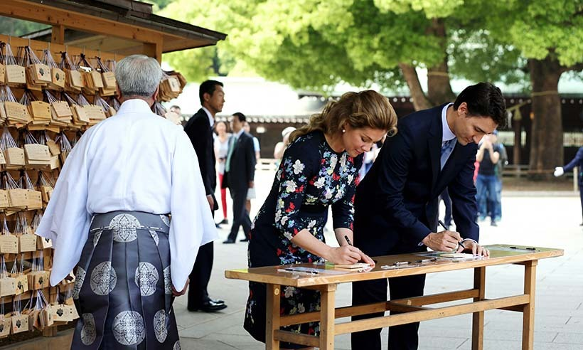 Prime Minister Justin Trudeau and his wife Sophie wrote messages on traditional Ema wooden plaques during their visit to Tokyo's Meiji Jingu Shrine. 