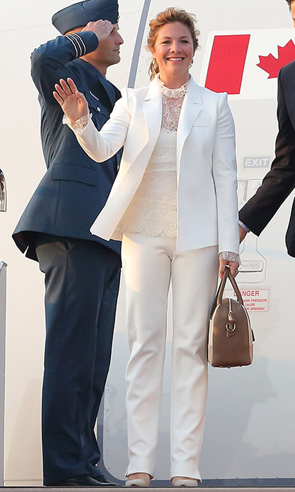 Sophie arrived at Hanaeda Airport in Japan with her husband, Prime Minister Justin Trudeau, wearing a white suit with lacy camisole by Marie Saint Pierre and toting a Want Les Essentials bag. Both brands are based in Quebec.