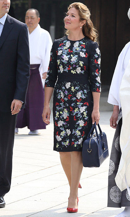 "Sophie stunned in a floral-print dress and bold red Zvelle pumps for a trip to the Meiji Shrine, where she hung a prayer for ""Courage, Love, Light, Peace.""