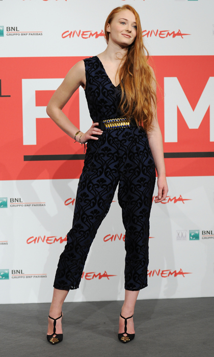 Upping the style stakes in a printed navy jumpsuit at the photo call for <i>Another Me</i> during the Rome Film Festival in 2013.  