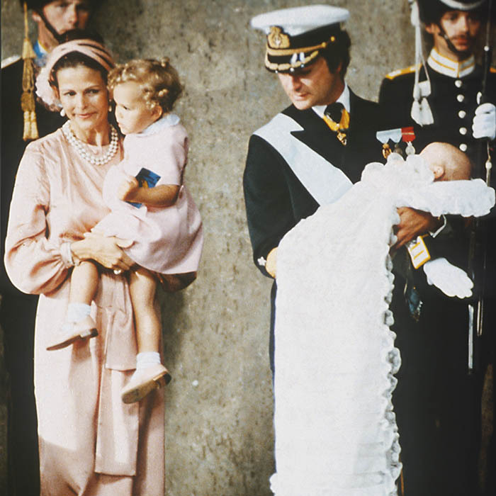 Watching over three-month-old Carl Philip during his baptism was his big sister Crown Princess Victoria. 