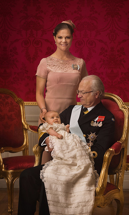 King Carl Gustaf and his two heirs, Princess Victoria and Princess Estelle, posed for a historic portrait following the little princess's christening service. 