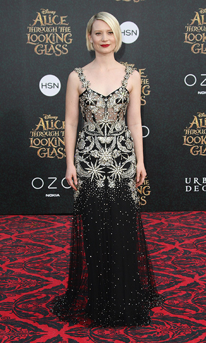 <em>Alice Through the Looking Glass</em> star Mia Wasikowska lights up the red carpet with a goth-glam gold-flecked Alexander McQueen gown at the film's Los Angeles premiere.