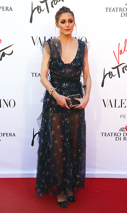 Olivia Palermo is a gold-star spangled dream in a chiffon Valentino gown, clutch and Jimmy Choo heels at the Opera of Rome. 