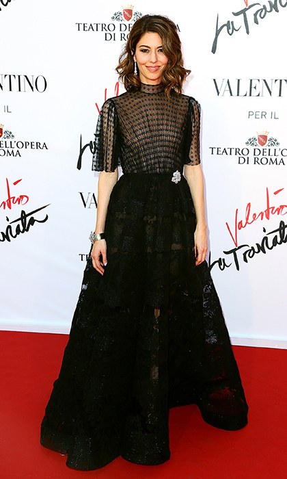 Director Sofia Coppola looks the part of a 1950s Italian film star in a black Valentino gown with a sheer blouse and full-skirted train at the Opera of Rome.