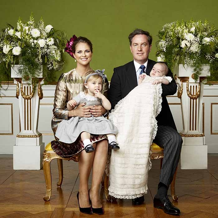 Prince Nicolas, dressed in the family's christening gown, joined his parents and big sister Princess Leonore for official portraits following the service.  