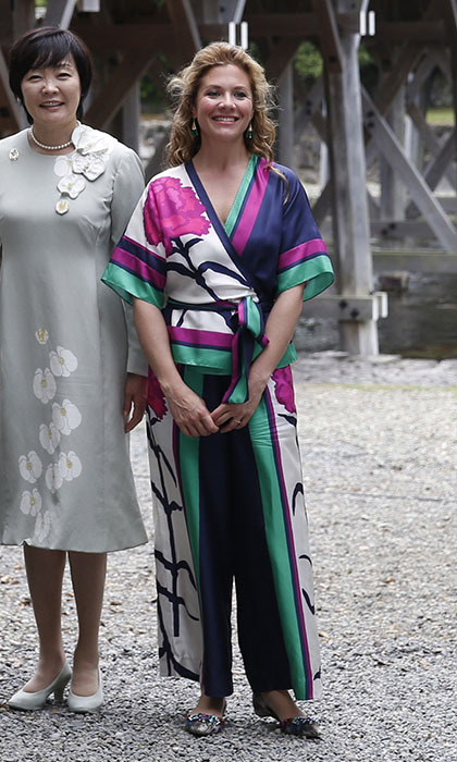 Sophie gives a nod to her host country in a kimono-style top with matching wide-legged trousers by Canadian designer Tanya Taylor and fan earrings by fellow Canuck Dean Davidson next to Ujibashi Bridge on the first day of the G7 leaders summit. 