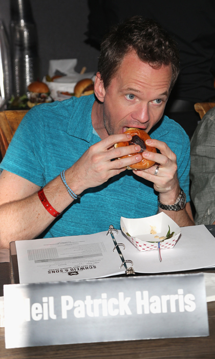 "Neil Patrick Harris once said that in his 20s he ""mostly ate burritos and nachos, and the occasional burger."" Here, the proud father proves he's still young at heart, digging into a gourmet patty at the Amstel Light Burger Bash in 2016.