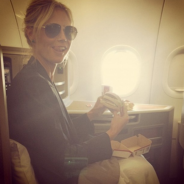 Not even supermodel Heidi Klum is immune to the appeal of a Big Mac. The <em>America's Got Talent</em> judge snapped a photo of herself preparing to chow down before taking flight.  