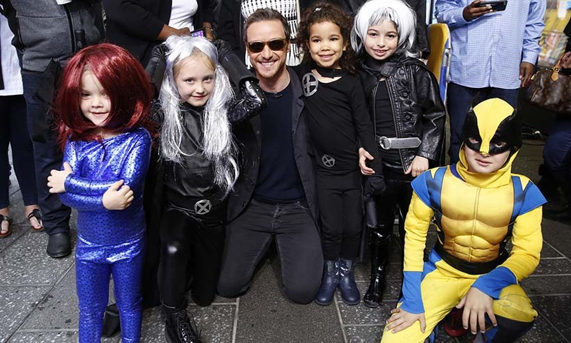 <i>X-Men: Apocalypse</i> star James McAvoy posed with some mini superheroes outside <i>Good Morning America</i> studios in New York. 
