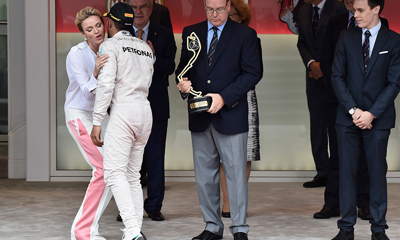 Princess Charlene embraces winner Lewis Hamilton. 