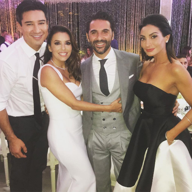 Mario and his wife Courtney with the bride and groom.