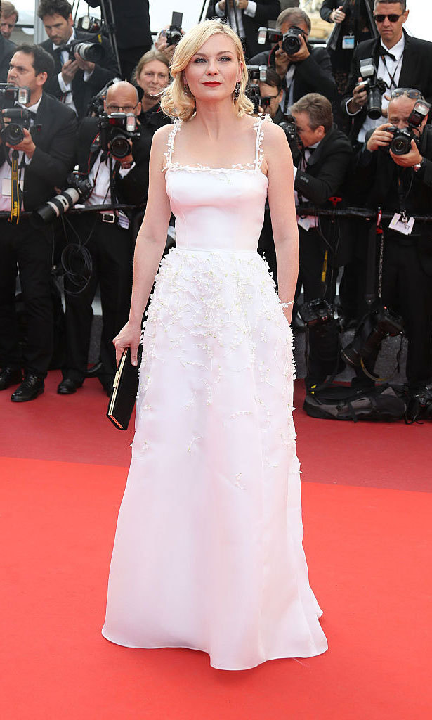 Kirsten Dunst stunned at the 2016 Cannes Film Festival wearing a white Christian Dior gown. The square neckline featuring appliqué florals highlighted the actress' waist, something many brides look for in their big-day look.
