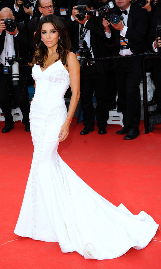 Years before her 2016 nuptials to Pepe Baston, Eva Longoria exuded bridal glamour stepping out in a strapless, Gabriela Cadena trumpet gown to the 2014 Cannes Film Festival premiere of <em>Saint Laurent</em>.