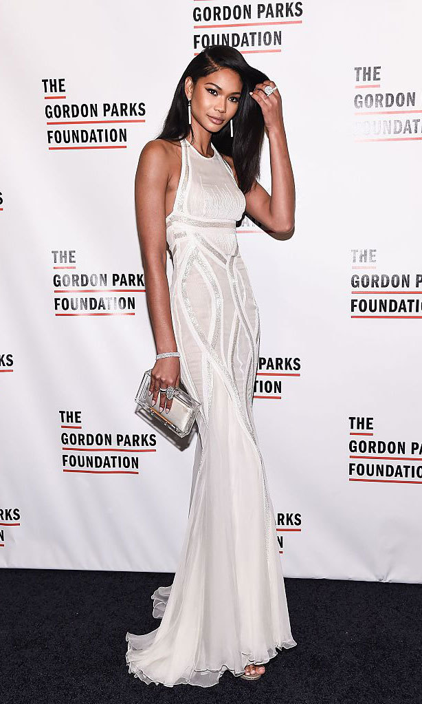 Model Chanel Iman dazzled at the 2016 Gordon Parks Foundation Awards Dinner wearing a halter Versace gown paired with Swarovski diamonds.