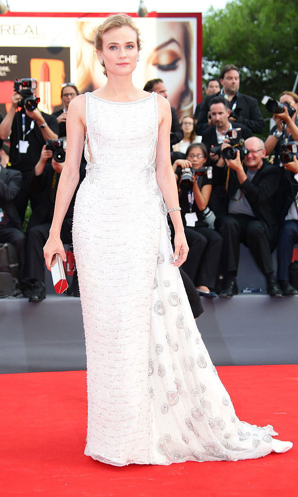 Diane Kruger wowed on the carpet of the <em>Everest</em> premiere during the 2015 Venice Film Festival wearing a high-neck Prada gown with a dramatic cape embroidered with crystal embellishments.